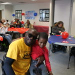 Volunteer Tony enjoying the Volunteer Luncheon with a little friend!